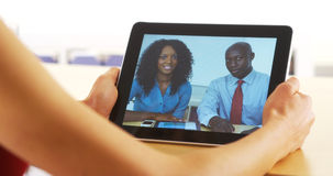 Closeup of black businesspeople talking on tablet Stock Photography