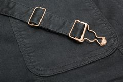 Closeup of a black denim with copper elements and seams stock photos