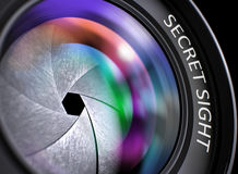 Closeup Black Digital Camera Lens with Secret Sight. 3D. Closeup Front Glass of Camera Lens with Pink and Orange Reflection and Inscription Secret Sight Stock Image