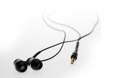 Closeup of a black earphones. Macro image. Shallow DOF royalty free stock photography