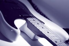 Closeup.black guitar on a white background. Closeup.black electric guitar on white background. photo with copy space Stock Images