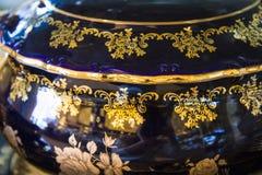 Closeup of black gilded pot Stock Photos