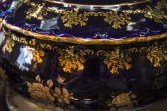 Closeup of black gilded pot Stock Photo