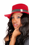 Closeup of black girl with red hat. Stock Photography