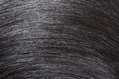 Closeup black hair as background. Royalty Free Stock Photography