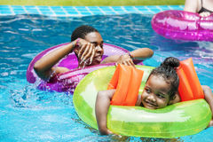 Closeup of black mother and daughter enjoying the pool with infl Stock Photography