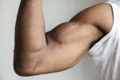Closeup of a black person`s muscular arm Stock Photo