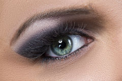 Closeup of black and purple glittery smokey eye Stock Image