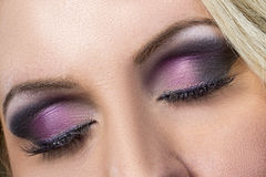 Closeup of black and purple smokey eye Royalty Free Stock Photo
