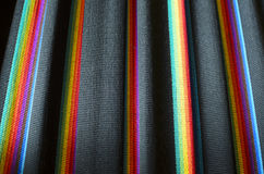 Closeup of black with rainbow stripes fabric Royalty Free Stock Image
