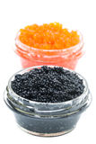 Closeup of black and red caviar in glass jars, isolated Stock Photo