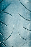 Closeup of black rubber motorcycle tire with round Royalty Free Stock Photo
