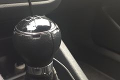 Closeup of a black and silver car gear stick. A closeup of a black and silver car gear stick royalty free stock photo