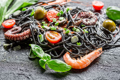 Closeup of black spaghetti with prawn Royalty Free Stock Images