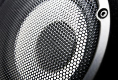 Closeup of a black speaker sub woofer Royalty Free Stock Images