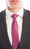 Closeup of black suit and pink necktie Stock Image