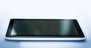 Closeup . black tablet pc . isolated on a black background. royalty free stock images