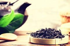 Closeup of black tea and teapot Stock Photos