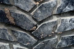 Closeup black tire of off road car have soil dirty Stock Image