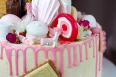 Closeup of black and white chocolate sponge cake with pink and chocolate decoration. Against the background of fabric drapery stock photos