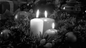 Closeup black and white image of burning candles on Christmas tree Stock Photo