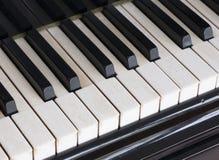 Black and white keys on old ivory keyboard of grand piano. Closeup of black and white keys on old ivory keyboard of antique bechstein grand piano Royalty Free Stock Image