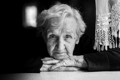 Closeup black and white portrait of an elderly woman. Royalty Free Stock Images