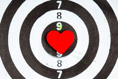Closeup black white target with heart bullseye as love background Stock Images