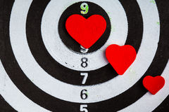 Closeup black white target with hearts bullseye as love background Royalty Free Stock Images
