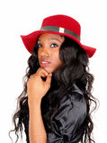 Closeup of black woman with red hat. Royalty Free Stock Photos