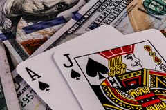 Closeup of a Blackjack 21 hand on a bed of one hundred dollar bills I Royalty Free Stock Photography