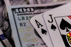 Closeup of a Blackjack 21 hand on a bed of one hundred dollar bills SHALLOW II Royalty Free Stock Photos