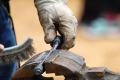 Closeup of blacksmith hand brushed metal forged products Stock Image