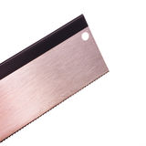 Closeup blade of tenon saw. Closeup of blade of a hand tenon saw used for cutting miters and tenons in cabinetmaking Royalty Free Stock Photography