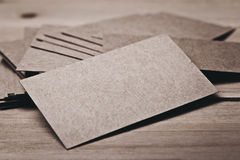 Closeup of blank business cards on wood table. Horizontal Stock Photos