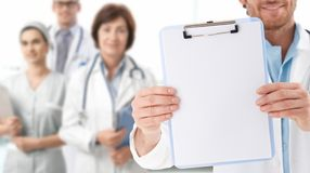 Closeup of blank clipboard held by doctor Stock Photos