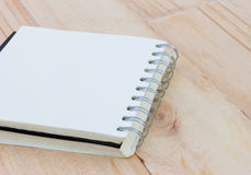 Closeup blank notebook on a brown wooden table, copyspace. Royalty Free Stock Photo