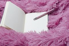 Closeup of blank open notebook,pen on fluffy plaid.Concept royalty free stock images