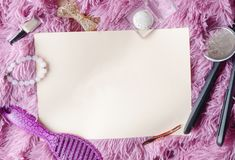 Top view of girl`s accessories and blank paper for text stock image