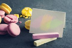 Closeup of blank paper and macaroons Royalty Free Stock Photos