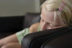 Closeup Of Blond Girl Sleeping On Sofa Stock Images