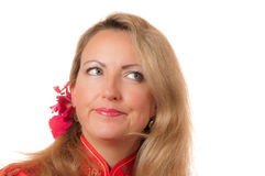Closeup of blond thoughtful woman. Closeup of beautiful thoughtful blond caucasian woman with flower in hair looking to one side Royalty Free Stock Photo