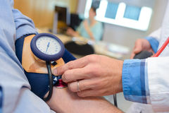Closeup blood pressure being taken. Closeup of blood pressure being taken Stock Photography