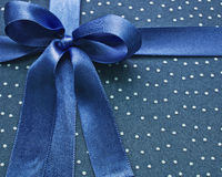 Closeup of blue bow on fabric Royalty Free Stock Images