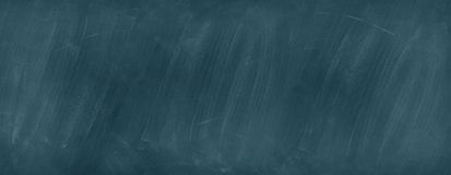 Blue chalkboard background. Closeup of blue chalkboard background stock photos