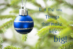 Closeup Of A Blue Christmas Ball With Life Quote. Closeup Of A Blue Christmas Ball With Silver Decoration With Life Quote Saying It Is The Little Things That Stock Images
