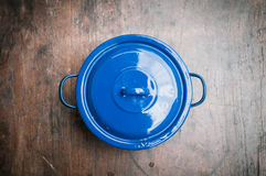 Closeup of blue cooking pot on wooden Stock Photo