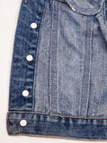 Closeup of a blue denim jacket. Texture Royalty Free Stock Photos