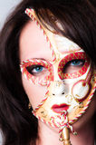 Closeup of blue eyed model with venetian carnival Royalty Free Stock Images