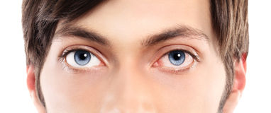 Closeup of blue eyes from a young man red and irritated eye with Royalty Free Stock Images
